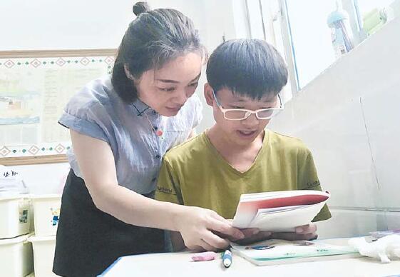 义乌市残联育智学校负责人周晓丽:从善念出发