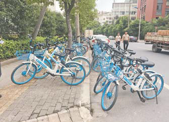 共享单车占道 宣传栏破损 北苑一电商产业园环境亟须提升