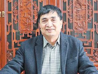 贾锦龙:做一名脚踏实地的政协委员